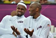 US forward LeBron James (L) chats with US guard Kobe Bryant (R) during the men's preliminary round basketball match USA vs Nigeria of the London 2012 Olympic Games at the basketball arena in London. The United States team of NBA stars set a record for most points in a single Olympic men's basketball game by defeating Nigeria 156-73 on Thursday in a preliminary round game