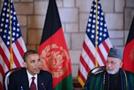 US President Barack Obama (L) speaks before signing a strategic partnership agreement with Afghan President Hamid Karzai at the Presidential Palace in Kabul. The wall of secrecy around Obama's visit to Afghanistan Tuesday cracked slightly under continual chatter on Twitter in a country obsessed by the instant communication site
