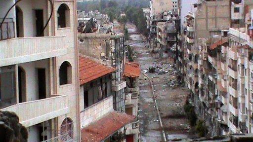 A Shaam News Network photo released June 24 claims to show destruction of residential buildings in Homs