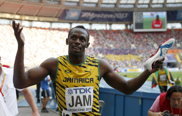 Jamaica's Usain Bolt celebrates his team's gold medal in the men's 4x100-meter relay final at the World Athletics Championships in the Luzhniki stadium in Moscow, Russia, Sunday, Aug. 18, 2013. (AP Photo/Matt Dunham)