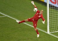 English goalkeeper Joe Hart dives for the ball during the Euro 2012 football championships match England vs Ukraine on June 19, 2012 at the Donbass Arena in Donetsk. AFP PHOTO / SERGEI SUPINSKY