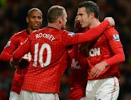 Manchester United's Wayne Rooney (centre) and Robin van Persie (right) at a Premier League match at Old Trafford on December 15, 2012. Alex Ferguson believes his team's trip to Swansea City is the start of a pivotal run of matches which will bring them closer to winning a 20th league title
