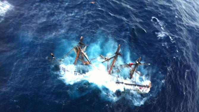 This photo provided by the U.S. Coast Guard shows the HMS Bounty, a 180-foot sailboat, submerged in the Atlantic Ocean during Hurricane Sandy approximately 90 miles southeast of Hatteras, N.C., Monday, Oct. 29, 2012. The Coast Guard rescued 14 of the 16 crew members by helicopter. Hours later, rescuers found one of the missing crew members, but she was unresponsive. They are still searching for the captain. (AP Photo/U.S. Coast Guard, Petty Officer 2nd Class Tim Kuklewski)