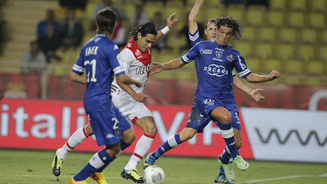 Monaco's Falcao of Colombia, center, Bastia's Fethi Harek of Algeria, left and Bastia's Francois J Modesto of France challenges for the ball during their French League One soccer match, in Monaco stadium, Wednesday, Sept, 25, 2013