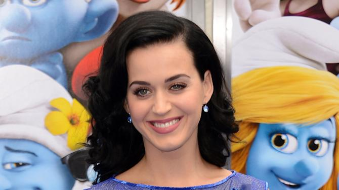 "FILE - This July 28, 2013 file photo shows singer Katy Perry at the world premiere of ""The Smurfs 2"" in Los Angeles. Perry will be the final act of the month-long London festival. It kicks off Sept. 1 with another diva, Lady Gaga, and will feature Robin Thicke, Elton John, Justin Timberlake, John Legend, Kendrick Lamar and the Kings of Leon, among others. (Photo by Jordan Strauss/Invision/AP, File)"