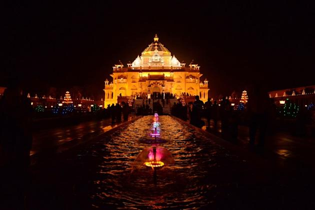 A view of the illuminated Akshardham Temple in Gandhinagar, some 30 kms from Ahmedabad, on the occasion of Diwali on November 13, 2012. The Akshardham Temple is lit with thousands of oil lamps which w