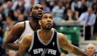 Tim Duncan of the San Antonio Spurs battles for position with Al Jefferson of the Utah Jazz during the 2012 NBA Playoffs in Salt Lake City, Utah on May 7. The Spurs swept the Jazz out of the first round of the NBA playoffs Monday, holding on for an 87-81 win thanks to a balanced attack that saw five players score double figures