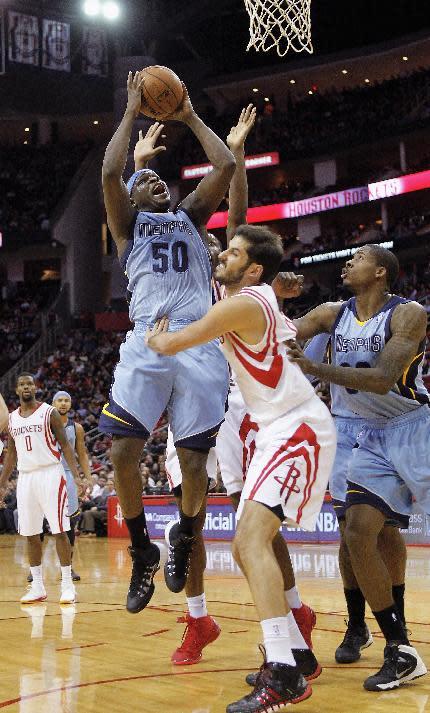 Memphis Grizzlies forward Zach Randolph  shoots over Houston Rockets forward Omri Casspi during the first half of an NBA basketball game Thursday, Dec. 26, 2013, in Houston
