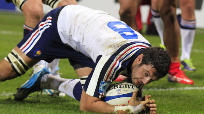 France's Damien Chouly scores a try during their rugby union test match against Tonga in Le Havre