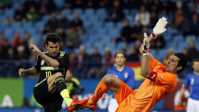 Spain's Fabregas fails to score past Italy's goalkeeper Buffon during their international friendly match in Madrid