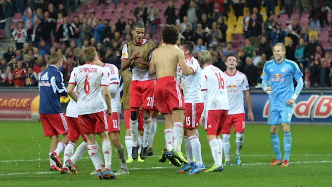 Salzburg's  players celebrate after  the Europa League group C soccer match  between Red  Bull Salzburg and Standard de Liege  in Salzburg, Austria, Thursday, Oct.  24, 2013. Salzburg won 2-0