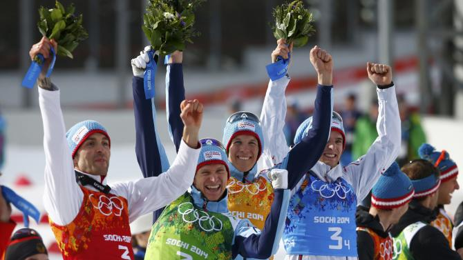 Norway's winning team members Moan, Klemetsen, Krog and Graabak celebrate on the podium during the flower ceremony for the of the Nordic Combined team Gundersen event of the Sochi 2014 Winter Olympic Games