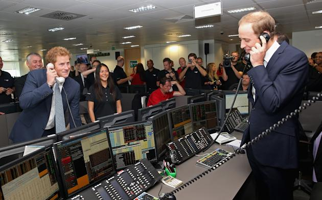 LONDON, ENGLAND - SEPTEMBER 11: Prince William, Duke of Cambridge and Prince Harry take part in a trade on at the BGC Partners trading floor during the BGC Charity Day 2013 at Canary Wharf on September 11, 2013 in London, England. The event is in memory of those who died in the World Trade Centre attacks and supports a number of UK charities. Prince William, Duke of Cambridge and Prince Harry were involved in a number of multi billion Euro trades during the morning. (Photo by Chris Jackson WPA Pool/Getty Images)