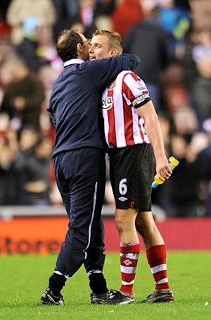 Lee Cattermole (right) expects Sunderland to move up the table under Martin O'Neill next season