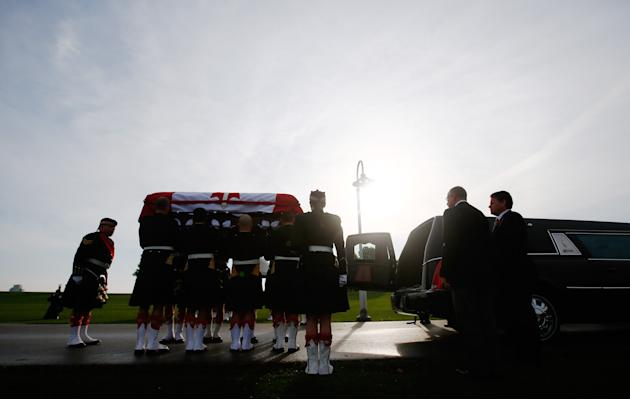 Soldiers load the coffin into a hearse during the funeral procession for Cpl. Nathan Cirillo in Hamilton