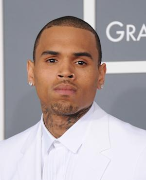 Chris Brown arrives at the 55th annual Grammy Awards on Sunday, Feb. 10, 2013, in Los Angeles.  (Photo by Jordan Strauss/Invision/AP)