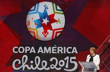 Chile's President Michelle Bachelet addresses the audience before the official draw for the 2015 edition of the Copa America soccer tournament in Vina del Mar
