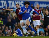 Aston Villa's defender Ron Vlaar (L) clashes with Everton's midfielder Marouane Fellaini during their English Premiership football match at Goodison Park in Liverpool, north-west England on February 2, 2013. The match ended in a 3-3 draw