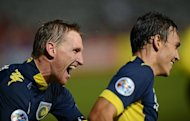 Central Coast Mariners' Daniel McBreen (L), seen here with teammate Trent Sainsbury during an AFC Champions League match at Gosford, near Sydney, on April 3, 2013. McBreen has signed with China's Shanghai SIPG on loan, Central Coast said on Saturday