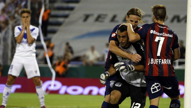 San Lorenzo's Torrico is congratulated by teammates after making save against Velez Sarsfield during the Argentine First Division Championship in Buenos Aires
