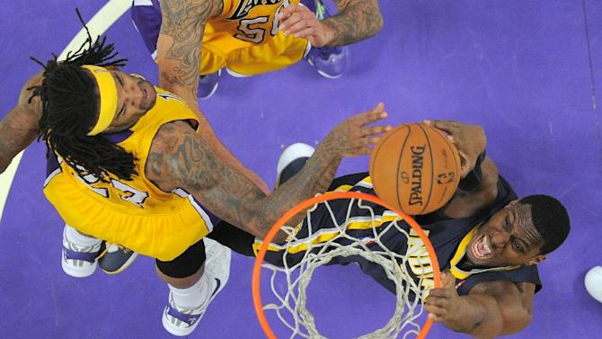 CHANGES NAME OF PACERS PLAYER - Indiana Pacers center Ian Mahinmi, right, of France, goes up for a dunk as Los Angeles Lakers forward Jordan Hill defends during the first half of an NBA basketball game, Tuesday, Jan. 28, 2014, in  Los Angeles