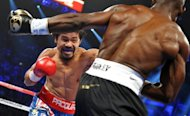 Manny Pacquiao (L) and Timothy Bradley during their WBO welterweight title match in Las Vegas on June 9. Pacquiao, who is reckoned the best pound-for-pound fighter in the world, said he thought he had done enough to win