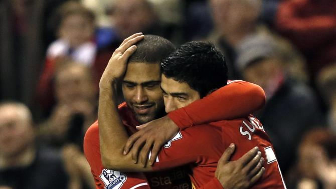 Liverpool's Suarez celebrates with team mate Johnson after scoring a goal against Hull City in Liverpool