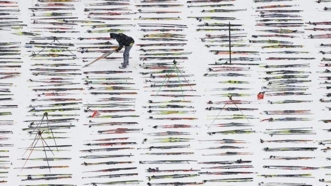 A man prepares skis for the annual Engadine cross country skiing marathon from Maloja to S-Chanf in south Eastern Switzerland, Sunday, March 13, 2011.  Around 12,000 sportsmen and women participated in the event and it is important to know where your skis are, and have them ready for the event. (AP Photo/Keystone/Alessandro Della Bella)