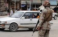 Paramilitary soldiers stand guard on a street in Quetta on. Gunmen killed four policemen in a drive-by shooting on the outskirts of Pakistan's troubled southwestern city of Quetta Saturday, police said
