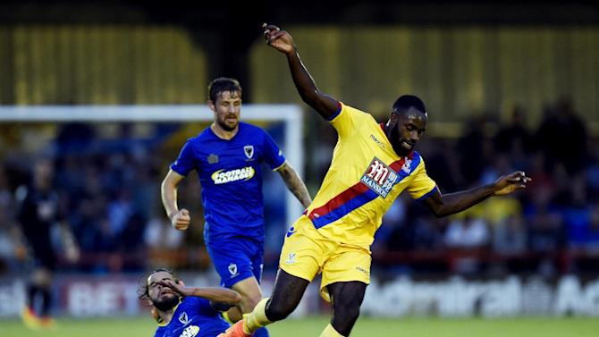 Crystal Palace's Hiram Boateng in action with AFC Wimbledon's Dan Gallagher