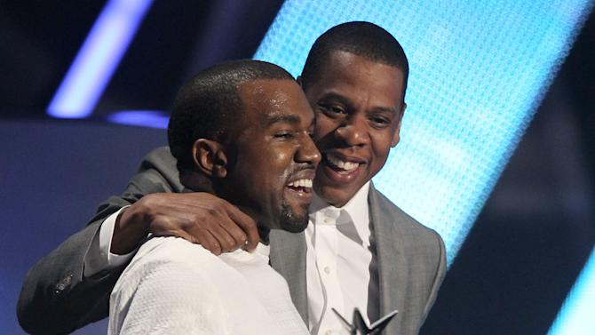 "Kanye West, left, and Jay-Z accept the award for best group for  ""The Throne"" at the BET Awards on Sunday,  July 1, 2012, in Los Angeles. (Photo by Matt Sayles/Invision/AP)"