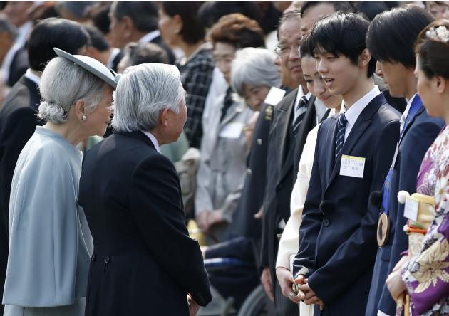 Japan's Emperor Akihito and Empress Michiko talk with Sochi Winter Olympics medallists at a spring garden party at the Akasaka Imperial Garden in Tokyo