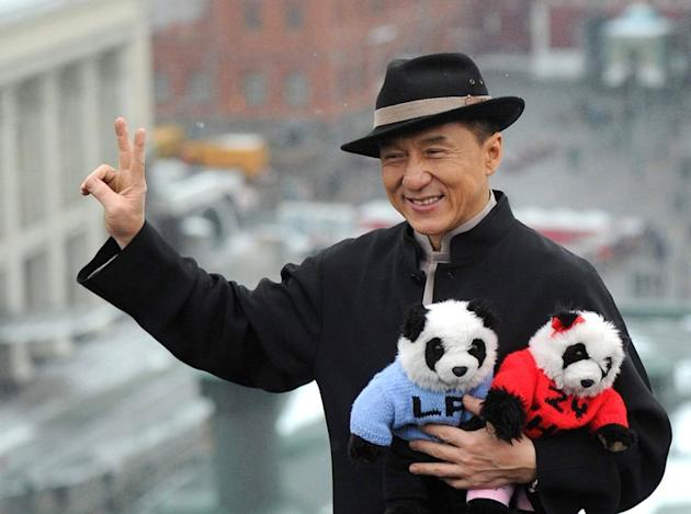 Hong Kong action film star Jackie Chan, pictured with toy pandas as he poses for photos during a visit to Moscow, on December 6, 2012. Chan provoked a furious fight-back from Hong Kongers after reportedly suggesting in a Chinese magazine interview that protests in his native city should be restricted