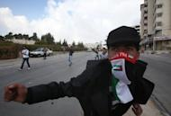 A Palestinian youth gestures during clashes with Israeli forces in the Halhul village near the West Bank city of Hebron. Israeli strikes killed 32 Palestinians on Monday, taking the Gaza death toll to 109 as UN chief Ban Ki-moon joined efforts to end the worst violence in four years and Israel's inner circle of ministers mulled their next move