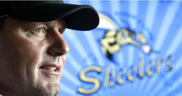 Roger Clemens talks with reporters after a news conference officially announcing his signing with the Sugar Land Skeeters baseball team, Tuesday, Aug. 21, 2012, in Sugar Land, Texas. Clemens, a seven-