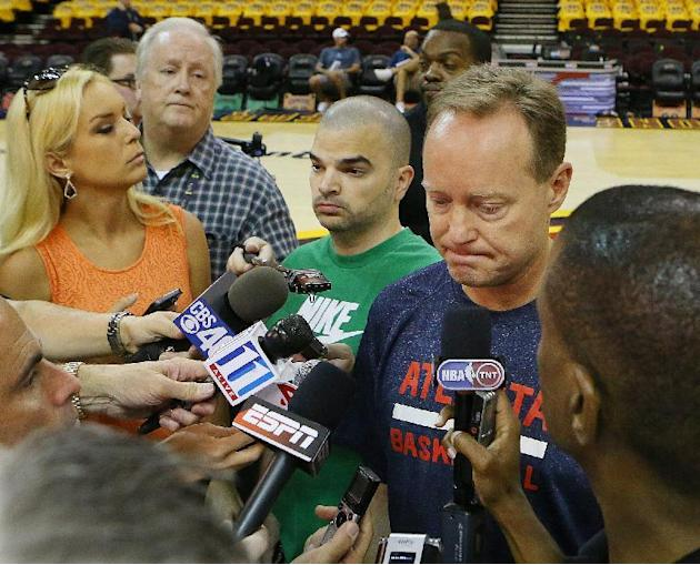 Atlanta Hawks head coach Mike Budenholzer talks to the media before Game 3 of the Eastern Conference finals of the NBA basketball playoffs against the Cleveland Cavaliers, Sunday, May 24, 2015, in Cle