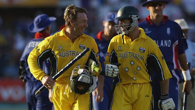 Michael Bevan and Andy Bichel of Australia walk back to the pavilion