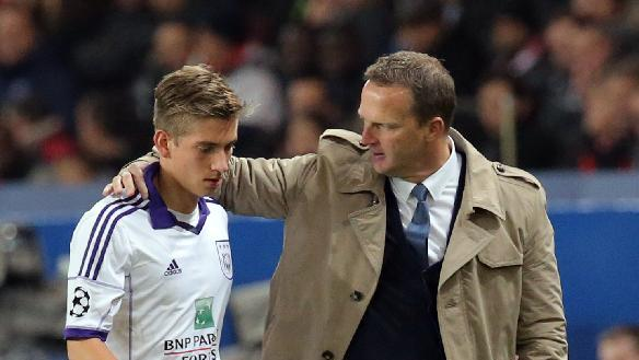 Anderlecht's coach John van den Brom, right, congratulates his player Dennis Praet as he leaves the pitch during their Champions League group C soccer match against Paris Saint Germain in Paris, France, Tuesday, Nov. 5, 2013. The match ended in a 1-1 draw