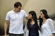 L-R: Spain's Enric Gonyalons and Ainhoa Fernandez Rincon and Italy's Rossella Urru arrive at the airport in Ouagadougou. The three aid workers released in Mali after being kidnapped by an Al-Qaeda-linked group, were freed in exchange for three Islamists, a negotiator said as they headed home