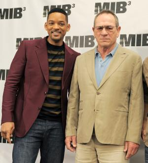 """FILE - In this May 3, 2012 file photo, Will Smith, left, and Tommy Lee Jones, cast members in the upcoming film """"Men in Black 3,"""" pose together at a photo call for the upcoming film in Beverly Hills, Calif.  The film opens in the U.S. on May 25. (AP Photo/Chris Pizzello, file)"""