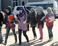 Syrian refugee girls head to school, November 27, in the Oncupinar camp in Kilis, southern Turkey. NATO foreign ministers are expected Tuesday to approve Turkey's request for deployment of Patriot missiles to counter a threat from Syria as Washington bluntly warned Damascus against the possible use of chemical weapons