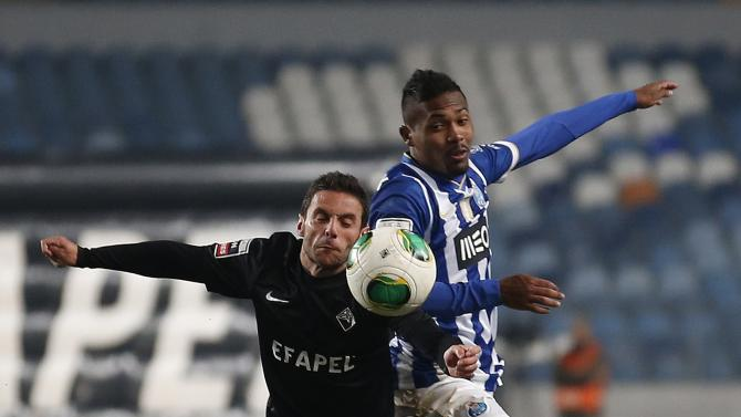Academica's Marinho fights for ball with Porto's Sandro during their Portuguese Premier League soccer match at the Coimbra city stadium in Coimbra