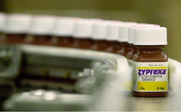FILE - In this April 10, 2003 file photo, bottles filled with the anti-psychotic drug Zyprexa sit on a packaging line at a Eli Lilly & Co. factory in Indianapolis. A study published in the New England