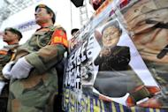 South Korean veterans are seen standing next to a caricature of North Korean leader Kim Jong-Un during an anti-North Korea rally to mark the 2nd anniversary of the sinking of the South Korean naval ship Cheonan, in Seoul, on March 16. N. Korea announced it would launch a long-range rocket next month to put a satellite into orbit, a move that would breach a UN ban imposed after previous launches