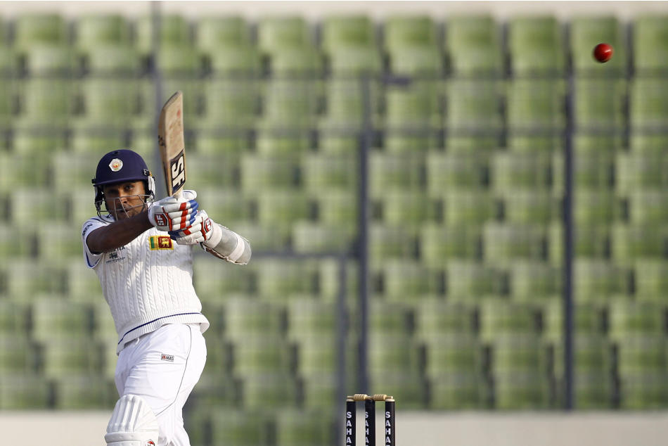 Sri Lankan cricket player Mahela Jayawardene bats on the second day of the first test cricket match against Bangladesh in Dhaka, Bangladesh, Tuesday, Jan. 28, 2014. (AP Photo/A.M. Ahad)
