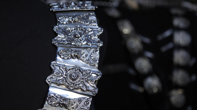 """In this image taken on Thursday, June 21, 2012, a detail of Michael Jackson's belt designed by his longtime costume and clothing designer, Michael Bush, is shown in Los Angeles. Bush tells the King of Pop's style secrets in a new photo-filled book, """"The King of Style: Dressing Michael Jackson"""" to be released on October 30, 2012. (AP Photo/Jae C. Hong)"""
