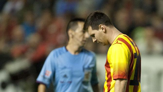 FC Barcelona's Lionel Messi of Argentina, right, walks on the pitch, during their Spanish League soccer match against Osasuna, at El Sadar stadium, in Pamplona northern Spain on Saturday, Oct. 19, 2013