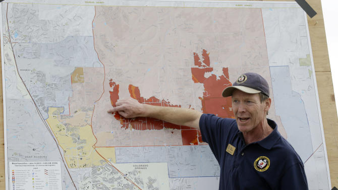 Incident Commander Rich Harvey gives an update on the Black Forest Fire during a news briefing in Colorado Springs, Colo., Friday, June 14, 2013. Little more than 36 hours after it started in the Black Forest area northeast of Colorado Springs, the blaze surpassed last June's Waldo Canyon fire as the most destructive in state history. (AP Photo/Marcio Jose Sanchez)