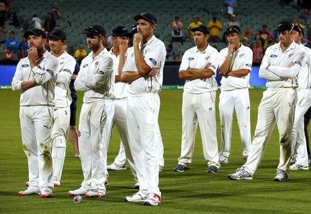 New Zealand's captain Brendon McCullum stands with teammates after they lost the third cricket test match against Australia at the Adelaide Oval, in South Australia