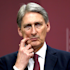 UK chancellor Philip Hammond is being asked about Uber's tax arrangements